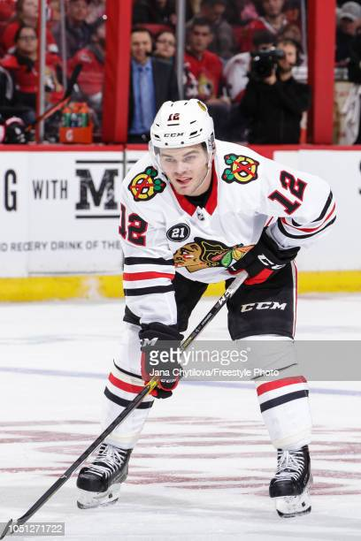 Alex DeBrincat of the Chicago Blackhawks prepares for a faceoff against the Ottawa Senators at Canadian Tire Centre on October 4 2018 in Ottawa...