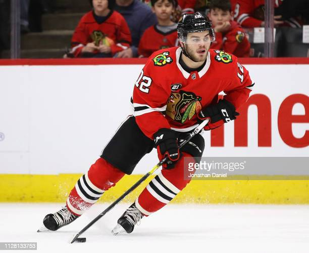 Alex DeBrincat of the Chicago Blackhawks prepares to shoot against the Vancouver Canucks at the United Center on February 07 2019 in Chicago Illinois