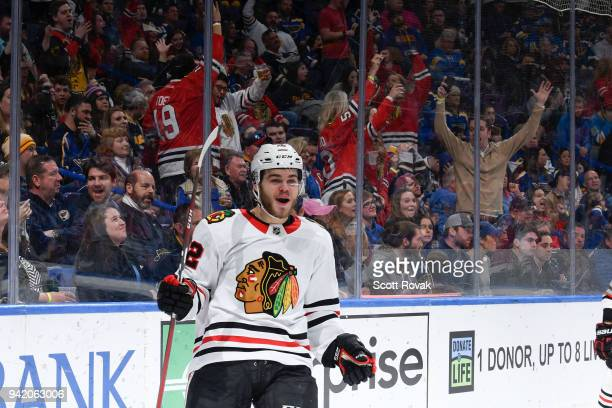 Alex DeBrincat of the Chicago Blackhawks reacts after scoring a goal against the St Louis Blues at Scottrade Center on April 4 2018 in St Louis...