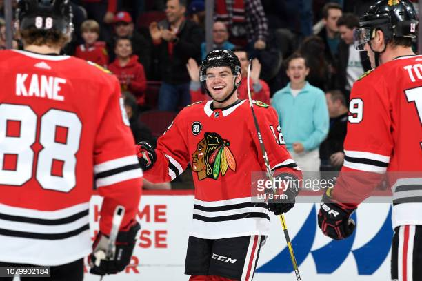 Alex DeBrincat of the Chicago Blackhawks reacts after scoring against the Nashville Predators in the first period at the United Center on January 9...