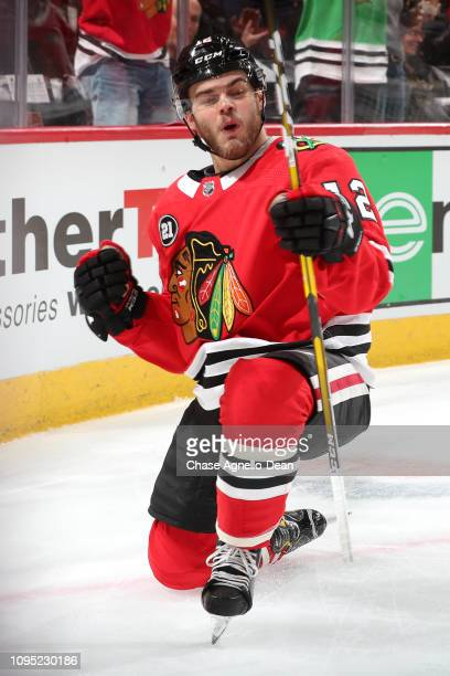 Alex DeBrincat of the Chicago Blackhawks reacts after scoring against the Vancouver Canucks in the second period at the United Center on February 7...