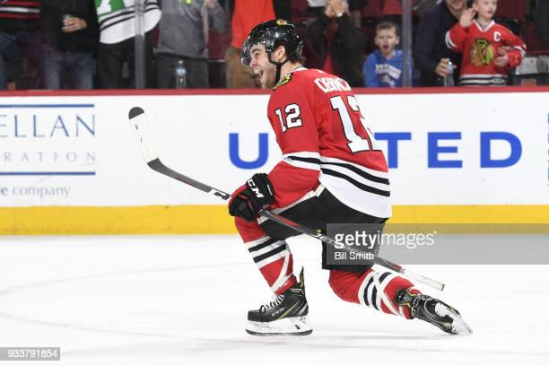 Alex DeBrincat of the Chicago Blackhawks reacts after scoring against the St Louis Blues in the third period for a hattrick at the United Center on...