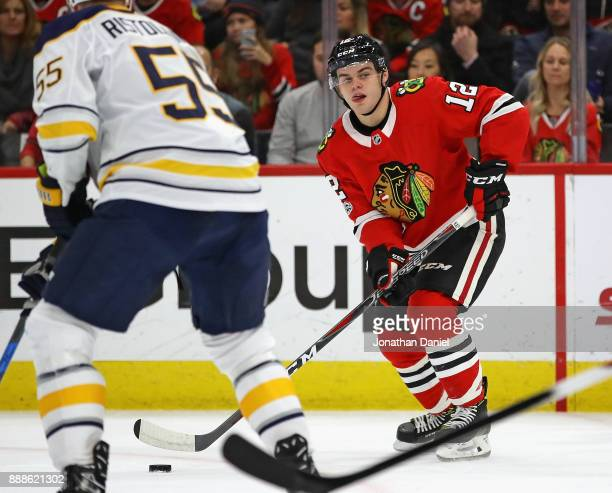 Alex DeBrincat of the Chicago Blackhawks readies to shoot and score a second period goal against the Buffalo Sabres at the United Center on December...