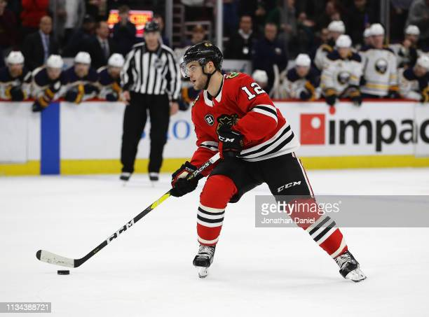 Alex DeBrincat of the Chicago Blackhawks readies to shoot the gamewinning goal in a shootout against the Buffalo Sabres at the United Center on March...