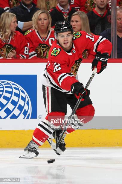 Alex DeBrincat of the Chicago Blackhawks receives the puck in the first period against the Colorado Avalanche at the United Center on March 6 2018 in...