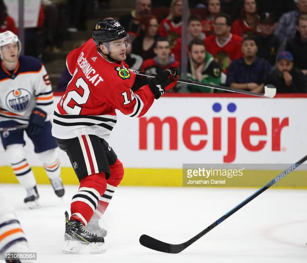 Alex DeBrincat of the Chicago Blackhawks scores his second goal of the game against the Edmonton Oilers at the United Center on March 05 2020 in...