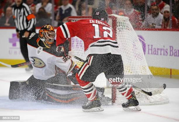 Alex DeBrincat of the Chicago Blackhawks scores his third goal of the game against Ryan Miller of the Anaheim Ducks at the United Center on November...