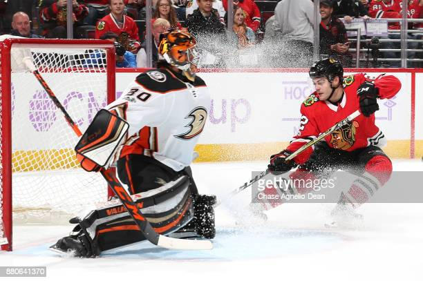 Alex DeBrincat of the Chicago Blackhawks scores on goalie Ryan Miller of the Anaheim Ducks in the second period at the United Center on November 27...