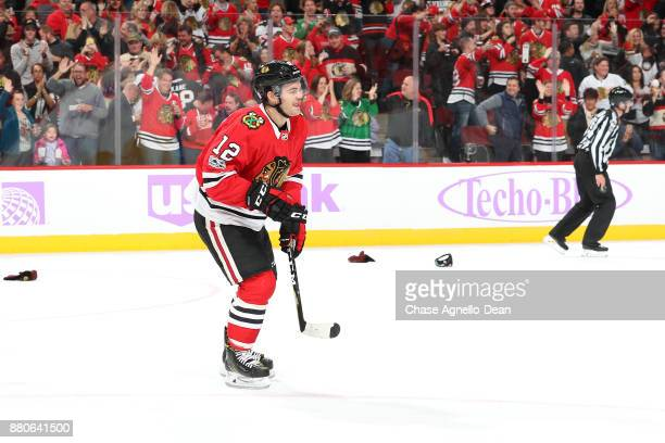 Alex DeBrincat of the Chicago Blackhawks skates across the ice after scoring a hattrick in the second period against the Anaheim Ducks at the United...