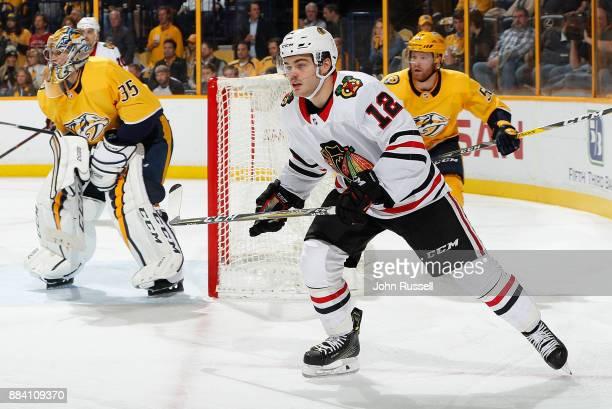 Alex DeBrincat of the Chicago Blackhawks skates against the Nashville Predators during an NHL game at Bridgestone Arena on November 28 2017 in...