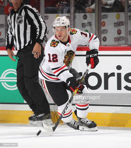 Alex DeBrincat of the Chicago Blackhawks skates against the New Jersey Devils at the Prudential Center on January 14 2019 in Newark New Jersey The...