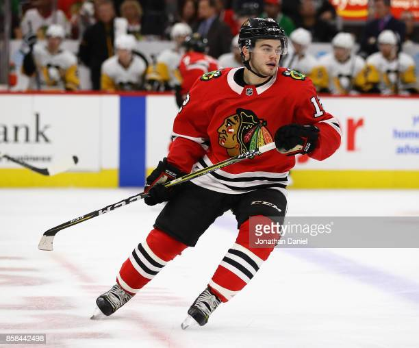 Alex DeBrincat of the Chicago Blackhawks skates against the Pittsburgh Penguins during the season opening game at the United Center on October 5 2017...