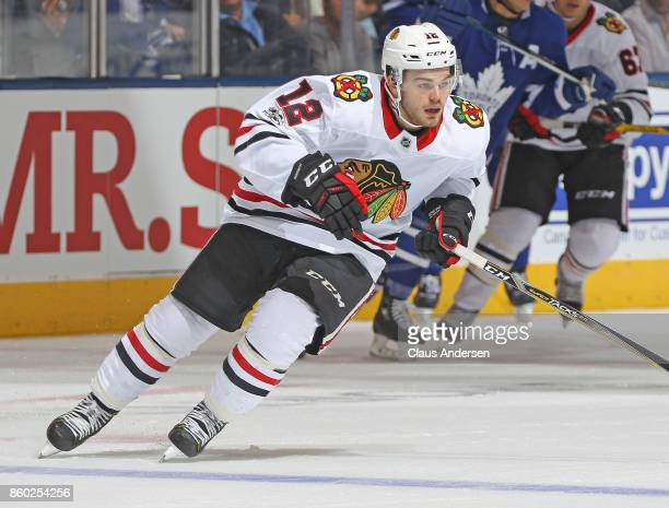 Alex DeBrincat of the Chicago Blackhawks skates against the Toronto Maple Leafs in an NHL game at the Air Canada Centre on October 9 2017 in Toronto...