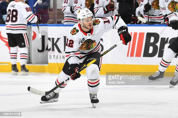 Alex DeBrincat of the Chicago Blackhawks skates during the game against the Edmonton Oilers on February 5 2019 at Rogers Place in Edmonton Alberta...