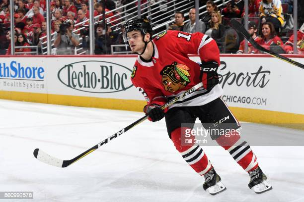 Alex DeBrincat of the Chicago Blackhawks skates during the game against the Pittsburgh Penguins at the United Center on October 5 2017 in Chicago...