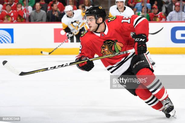 Alex DeBrincat of the Chicago Blackhawks skates in the third period against the Pittsburgh Penguins at the United Center on October 5 2017 in Chicago...