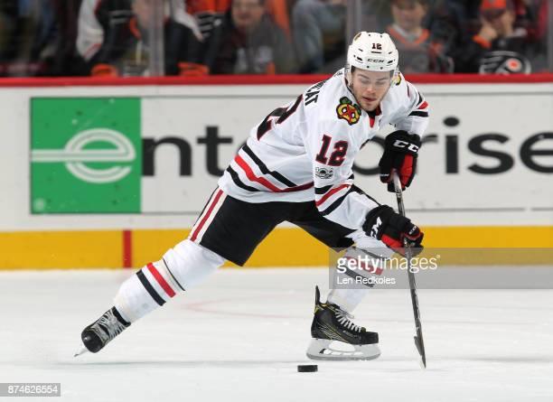 Alex DeBrincat of the Chicago Blackhawks skates the puck against the Philadelphia Flyers on November 9 2017 at the Wells Fargo Center in Philadelphia...