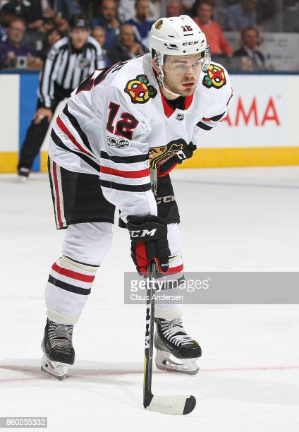 Alex DeBrincat of the Chicago Blackhawks waits for a faceoff against the Toronto Maple Leafs in an NHL game at the Air Canada Centre on October 9...