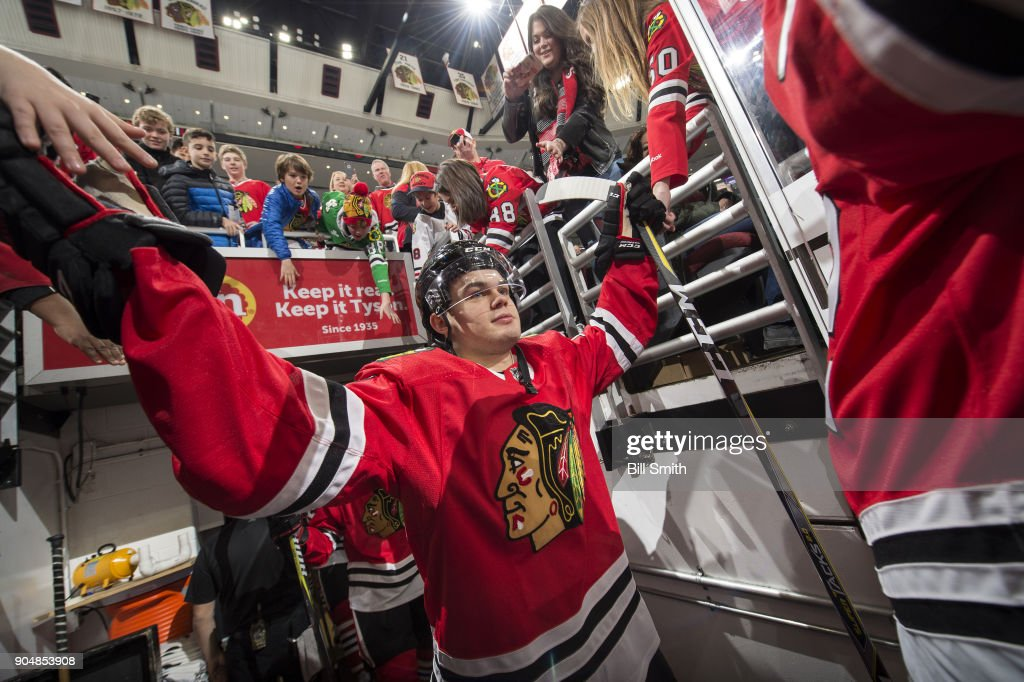 Alex DeBrincat #12 of the Chicago Blackhawks walks out to the ice prior to the game against the Detroit Red Wings at the United Center on January 14, 2018 in Chicago, Illinois.