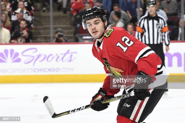 Alex DeBrincat of the Chicago Blackhawks watches for the puck in the third period against the Anaheim Ducks at the United Center on November 27 2017...