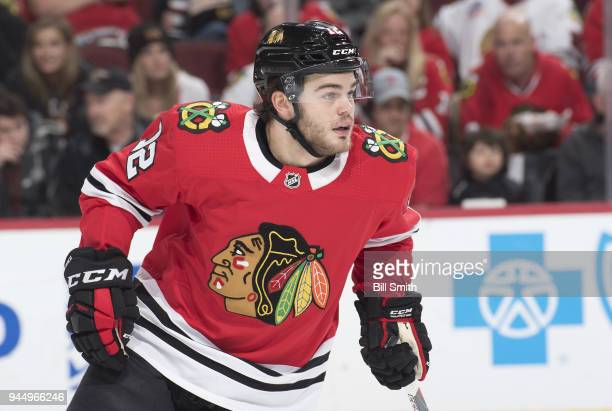 Alex DeBrincat of the Chicago Blackhawks watches for the puck in the first period against the Winnipeg Jets at the United Center on March 29 2018 in...