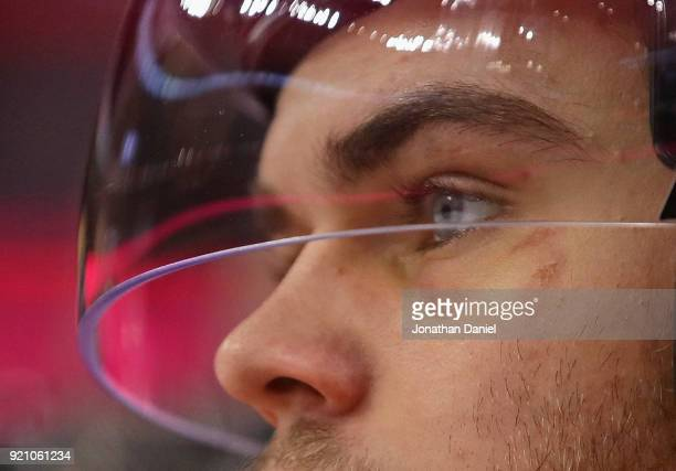 Alex DeBrincat of the Chicago Blackhawks watches from the bench as his teammates take on the Los Angeles Kings at the United Center on February 19...