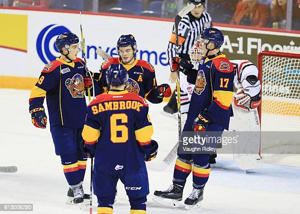 Alex DeBrincat of the Erie Otters celebrates a goal with teammates during the first period of an OHL game against the Niagara IceDogs at the Meridian...