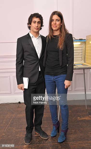 Alex Dellal and Charlotte Casiraghi attend the opening night of 'The Embassy' exhibition at 33 Portland Place on October 15 2009 in London England
