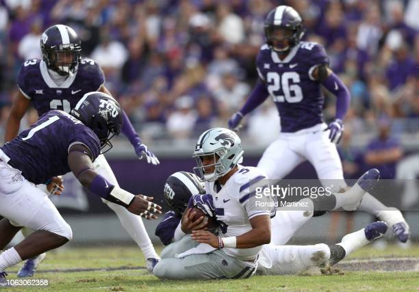 Alex Delton of the Kansas State Wildcats is tackled by Arico Evans of the TCU Horned Frogs in the first half at Amon G Carter Stadium on November 03...