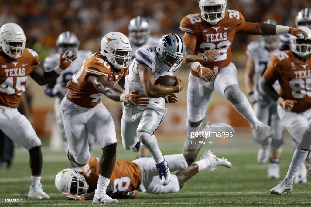 Alex Delton #5 of the Kansas State Wildcats runs the ball and is tackled by Naashon Hughes #40 of the Texas Longhorns in the fourth quarter at Darrell K Royal-Texas Memorial Stadium on October 7, 2017 in Austin, Texas.
