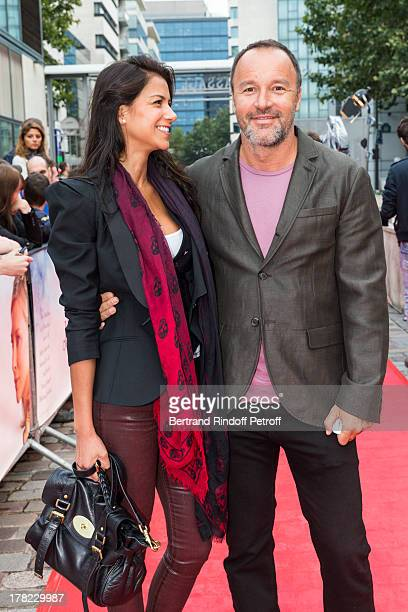 Alex Denis manager of Paris' famed restaurant L'Avenue and his wife actress Catalina Denis arrive to the Paris premiere of Blue Jasmine at UGC Cine...