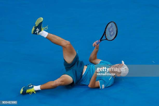 Alex Di Minaur of Australia falls attempting a return in his first round match against Tomas Berdych of the Czech Republic on day two of the 2018...