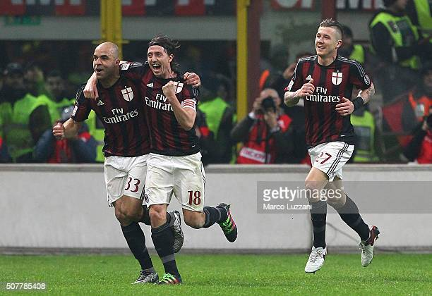 Alex Dias da Costa of AC Milan celebrates with his teammate Riccardo Montolivo after scoring the opening goal during the Serie A match between AC...