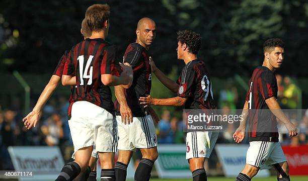 Alex Dias da Costa of AC Milan celebrates with his teammates after scoring his goal during the preseason friendly match between AC Milan and Legnano...