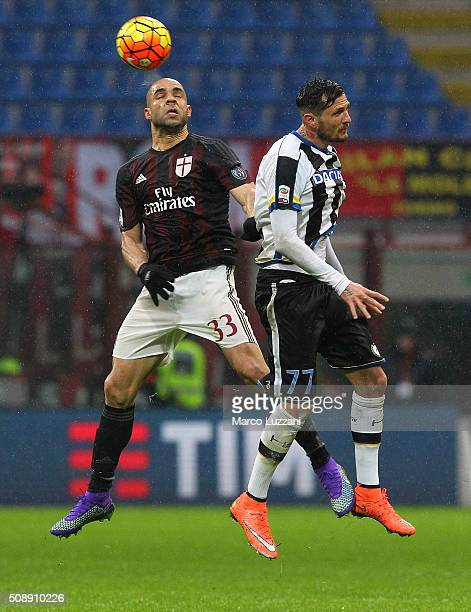Alex Dias da Costa of AC Milan competes for the ball with Cyril Thereau of Udinese Calcio during the Serie A match between AC Milan and Udinese...