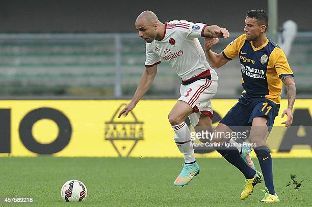 Alex Dias Da Costa of AC Milan competes the ball with Bosko Jankovic of Hellas Verona FC during the Serie A match between Hellas Verona FC and AC...