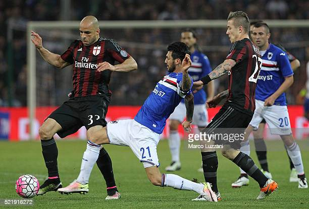 Alex Dias da Costa of AC Milan is challenged by Roberto Soriano of UC Sampdoria during the Serie A match between UC Sampdoria and AC Milan at Stadio...