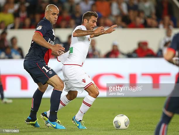 Alex Dias Da Costa of PSG and Adrian Mutu of AC Ajaccio in action during the Ligue 1 match between Paris Saint Germain FC and AC Ajaccio at the Parc...