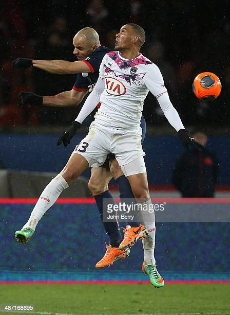 Alex Dias Da Costa of PSG and Guillaume Hoarau of Bordeaux in action during the Ligue 1 match between Paris SaintGermain FC and FC Girondins de...