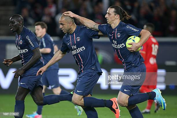 Alex Dias Da Costa of PSG celebrates his goal with teammate Zlatan Ibrahimovic during the Ligue 1 match between Paris SaintGermain FC and...