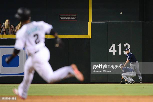 Alex Dickerson of the San Diego Padres makes the throw over teammate Travis Jankowski as Jean Segura of the Arizona Diamondbacks rounds second base...