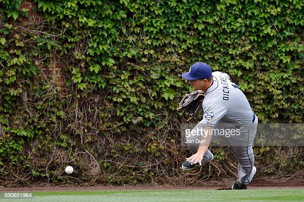 Alex Dickerson of the San Diego Padres plays the ball off the wall on a hit by Tim Federowicz of the Chicago Cubs during the fourth inning in game...