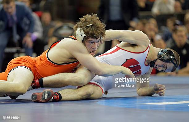 Alex Dieringer of the Oklahoma State Cowboys wrestles Isaac Jordan of the Wisconsin Badgers during the finals of the NCAA Wrestling Championships on...