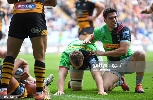 Alex Dombradnt of Harlequins is consoled by Sam Hidalgo-Clyne of Harlequins after failing to score during the Gallagher Premiership Rugby match...