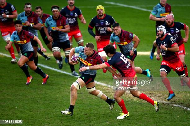 Alex Dombrandt of Harlequins breaks the Grenoble defence line during the Challenge Cup match between Harlequins and Grenoble Rugby at Twickenham...