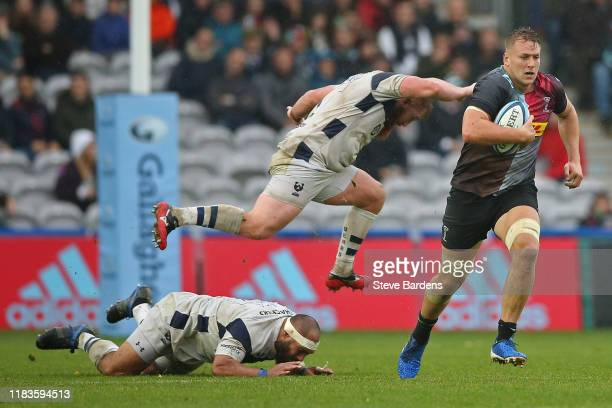Alex Dombrandt of Harlequins breaks the tackle of John Afoa of Bristol Bears during the Gallagher Premiership Rugby match between Harlequins and...