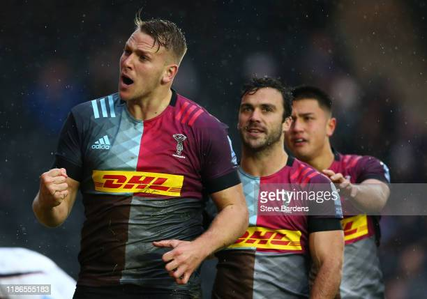 Alex Dombrandt of Harlequins celebrates scoring the opening try during the Gallagher Premiership Rugby match between Harlequins and Worcester...