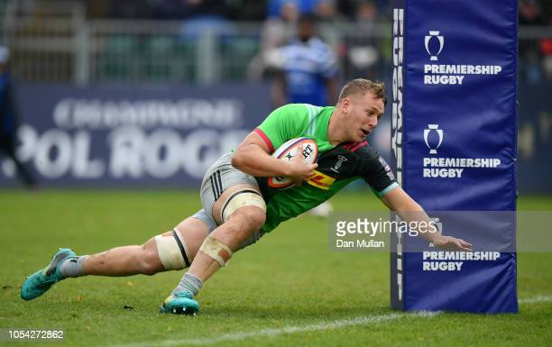Alex Dombrandt of Harlequins dives over to score his side's second try during the Premiership Rugby Cup match between Bath Rugby and Harlequins at...