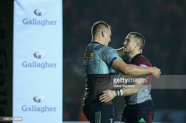 Alex Dombrandt of Harlequins is congratulated by Mike Brown after scoring the first try during the Gallagher Premiership Rugby match between...