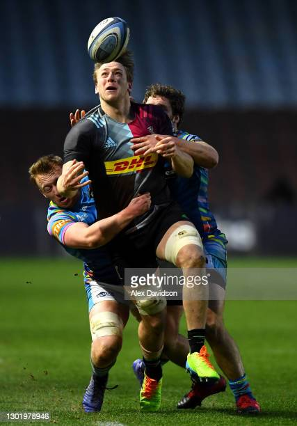 Alex Dombrandt of Harlequins is tackled by Tommy Reffell and Julián Montoya of Leicester Tigers during the Gallagher Premiership Rugby match between...
